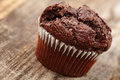 Chocolate muffin closeup of a on a rustic wooden board Stock Image