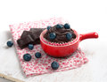 Chocolate muffin cupcake with and blueberry on a table blueberry Royalty Free Stock Photos