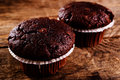 Chocolate muffin on wood table Stock Image