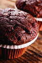 Chocolate muffin on wood table Stock Photo