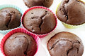 Chocolate muffins in colorful silicone forms sweet dessert Stock Photography