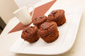 Chocolate muffins with a cup of coffee on white plate Royalty Free Stock Photo