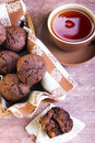 Chocolate muffins and cup of tea apricot with Stock Photography