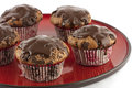 Chocolate muffins tasty with decoration on a red ceramics plate Royalty Free Stock Photography