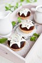 Chocolate muffins with vanilla frosting Stock Photos
