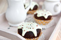 Chocolate muffins with vanilla frosting Royalty Free Stock Images