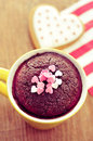 Chocolate mug cake and heart shaped cookie filtered high angle shot of a topped with confetti sprinkles a on a wooden table Stock Photography