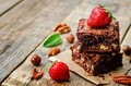 Chocolate nut brownie cake decorated with strawberries Royalty Free Stock Photo