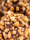 Chocolate nut truffle with nuts topping macro shot Royalty Free Stock Photo