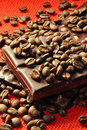 Chocolate with nuts and coffee beans Stock Image