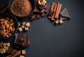 Chocolate nuts sweets spices and brown sugar black milk cocoa powder on a black background food concept Royalty Free Stock Images
