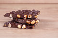 Chocolate with nuts on a wooden background Stock Photography