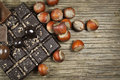 Chocolate with nuts on a wooden background Stock Images