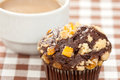 Chocolate orange muffin and coffee cup Stock Images