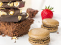 Chocolate passion best dessert for women brownie french macarons and strawberry Royalty Free Stock Photo