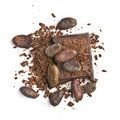 Chocolate pieces with cocoa beans Stock Images