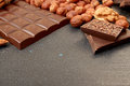 Chocolate pieces, filbert, walnut, almond, chocolate shavings Royalty Free Stock Photo