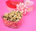 Chocolate popcorn in heart shape bow Stock Image