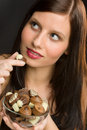 Chocolate - portrait young woman eat candy Royalty Free Stock Image