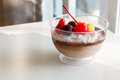 Chocolate pudding mousse with mix fruit and cream on top Stock Photos
