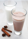 Chocolate and regular milk Royalty Free Stock Images