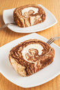 Chocolate roll cake on plate white Royalty Free Stock Images
