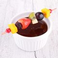 Chocolate sauce and fruits close up on Stock Image