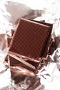 Chocolate on silver foil Royalty Free Stock Photo