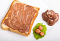 Chocolate spread and filbert nuts bread with close up Royalty Free Stock Image