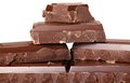 Chocolate stacked pieces in light back Royalty Free Stock Photo
