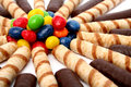 Chocolate sticks with a cream and the multi-coloured sweets Stock Image