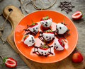 Chocolate strawberry ghosts - sweet and healthy halloween snack Royalty Free Stock Photo