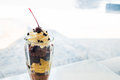 Chocolate sundae in the clear glass cup Royalty Free Stock Photo