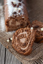 Chocolate swiss roll cake with coffee cream on a wooden background selective focus Royalty Free Stock Photo