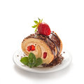 Chocolate swiss roll cake with strawberries Royalty Free Stock Photo