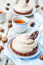 Chocolate tartlet with chestnut cream frosting toning selective focus Royalty Free Stock Photo