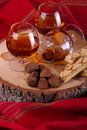Chocolate truffle and cognac with brandy balloon pastries puff pastry on pine stump with red cloth background Stock Image