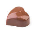 Chocolate truffle in shape of the heart on white background Royalty Free Stock Photography