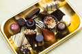 Chocolate truffles different kinds of handmade filled pralines on tray Stock Photography