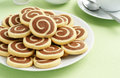 Chocolate and Vanilla Pinwheel Cookies with Tea Royalty Free Stock Photo
