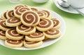 Chocolate and Vanilla Pinwheel Cookies with Tea Royalty Free Stock Photo