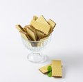 Chocolate wafers in glass rummer on white background Royalty Free Stock Photo