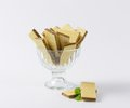 Chocolate wafers in glass rummer on white background Stock Photography
