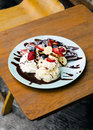 Chocolate waffles with ice cream, banana, strawberry and blueber Royalty Free Stock Photo