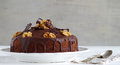 Chocolate walnut cake with chocolate glazing a home made Stock Photo