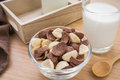 Chocolate and white chocolate cereals in bowl with milk glass Royalty Free Stock Photo
