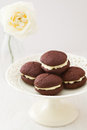 Chocolate whoopie pies on cake stand Royalty Free Stock Photo