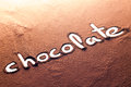 Chocolate written with cocoa powder Royalty Free Stock Photo