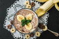 Chocolate yogurt with banana slices and a sprig of mint. Close-up. Top view Royalty Free Stock Photo