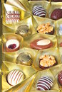 Chocolates assortment of in a golden box Royalty Free Stock Photos